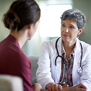 A caring and compassionate doctor speaks to her patient about her preventive care.